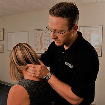 Chiropractor Cheyenne WY Dr Dean Lehmkuhler and Patient Exam